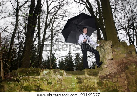 goth guy in business clothes - stock photo