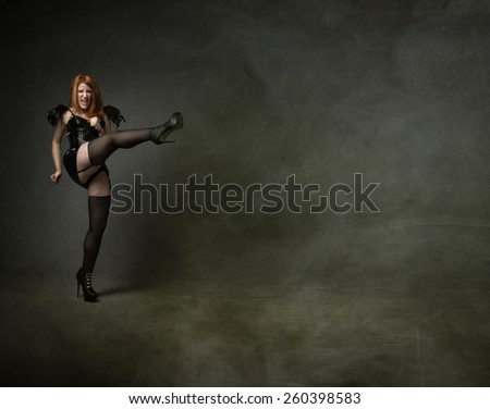 goth person kicking empty space - stock photo