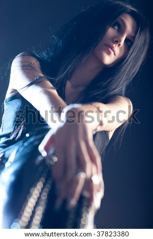 Goth woman. Focus on face. - stock photo