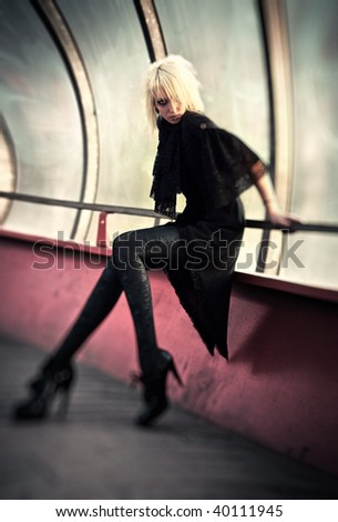 Goth woman in industrial tunnel. Surreal lens distortion effect. - stock photo