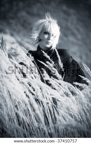 Goth woman outdoors portrait. Dark blue and white colors. - stock photo