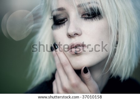 Goth woman with white hair outdoors portrait. Shallow dof effect. - stock photo