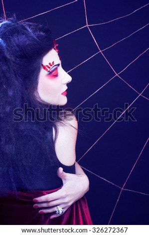 Goth. Young woman in creative image. - stock photo
