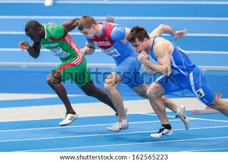 GOTHENBURG, SWEDEN - MARCH 1 Aleksander Brednev (Russia) places 3rd in heat 3 of the men's 60m event during the European Athletics Indoor Championship on March 1, 2013 in Gothenburg, Sweden. - stock photo