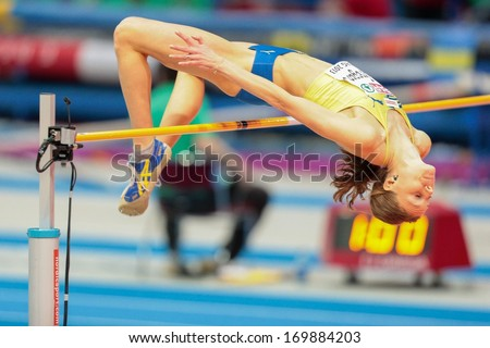 GOTHENBURG, SWEDEN - MARCH 2 Emma Green Tregaro (SWE) competes in the  women's high jump event during the European Athletics Indoor Championship on March 2, 2013 in Gothenburg, Sweden. - stock photo