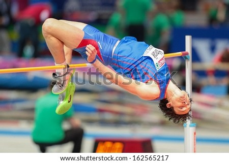 GOTHENBURG, SWEDEN - MARCH 1 Peter Horak (Slovakia) competes in the qualification of the men's high jump event during the European Athletics Indoor Championship on March 1, 2013 in Gothenburg, Sweden. - stock photo