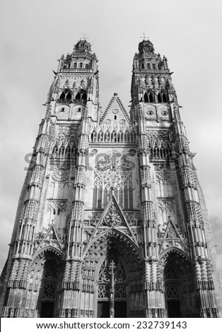 Gothic cathedral of Saint Gatien in Tours. (Val de Loire, France) Aged photo. Black and white. - stock photo