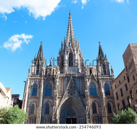 Gothic Catholic Cathedral Facade Steeples Barcelona Catalonia Spain. Built in 1298. This is the main spire. - stock photo