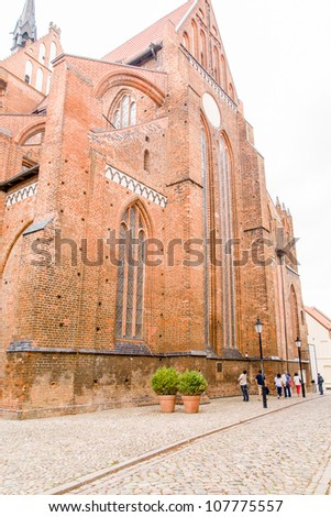 Gothic church in historic Wismar, a Hanseatic League town in Northern Germany on the Baltic Sea, with elegant building styles from 14th-century Gothic to 19th-century Romanesque revival. - stock photo
