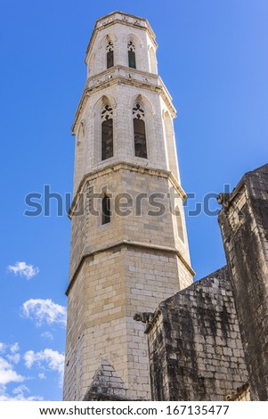 Gothic Church of Saint Peter near Dali's Theatre - Museum building in Figueres, Catalonia, Spain. Belltower. This is Cathedral in which in 1904 young Dali christened. - stock photo