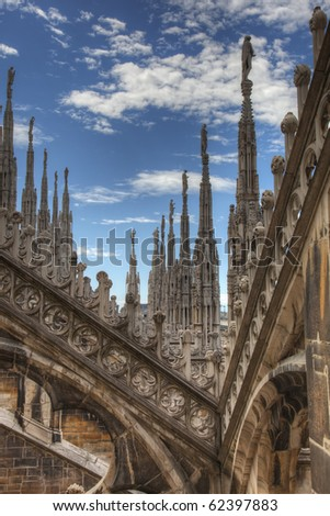 Gothic details and towers on top roof of the milan dome, duomo, in Italy - stock photo