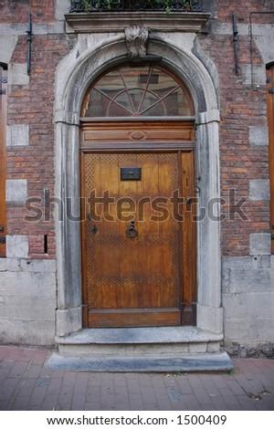 Gothic door in Mons, Belgium - stock photo