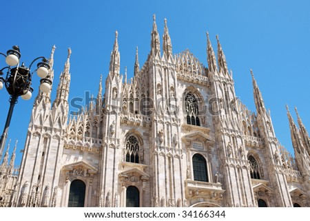 Gothic facade of Milan Cathedral in Piazza del Duomo. It is the fourth largest church in the world. The construction started in 1386 and took about five centuries. - stock photo