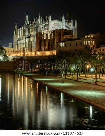"Gothic facade of the cathedral of Palma de Majorca and views of ""Sea Park"" - stock photo"