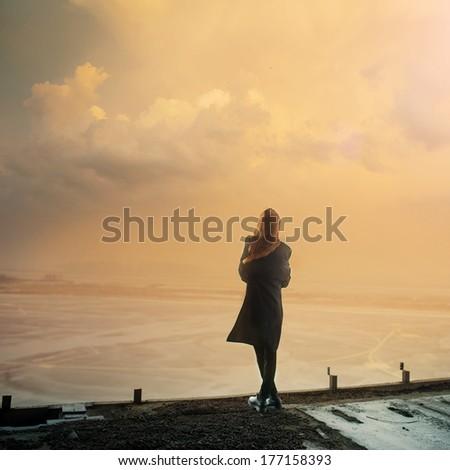 Gothic girl and sunset Photo - stock photo