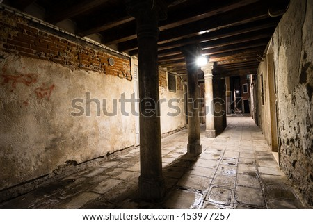 Gothic quarter with old red brick wall at night. Empty alleyways in Venice. - stock photo