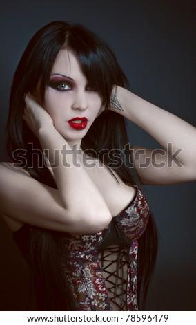 Gothic studio portrait of brunette sexy woman - stock photo