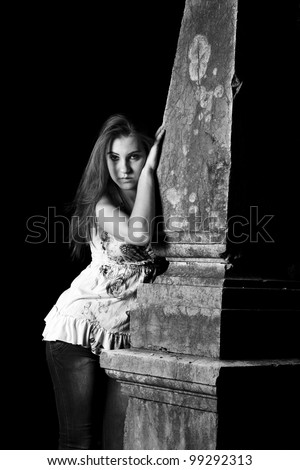 Gothic woman by the grave - stock photo