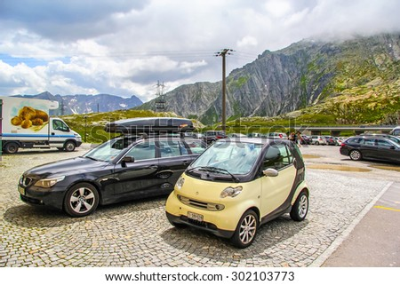 GOTTHARD PASS, SWITZERLAND - AUGUST 5, 2014: Motor car Smart Fortwo at the high Alpine mountain road. - stock photo