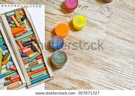Gouache and pastel crayons close-up. Kit the young artist. Development of creative thought. - stock photo