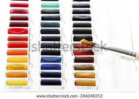gouache with two brushes - stock photo