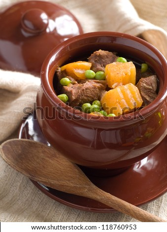 Goulash in pot with potayo and meat, selective focus - stock photo