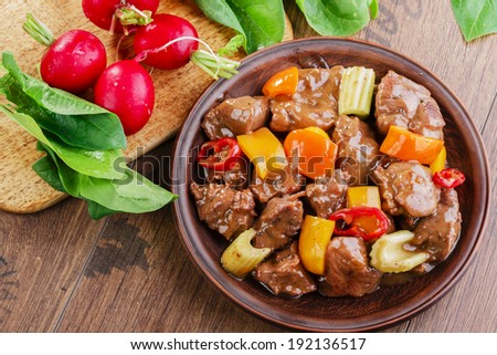 goulash meat with vegetables on the plate  - stock photo