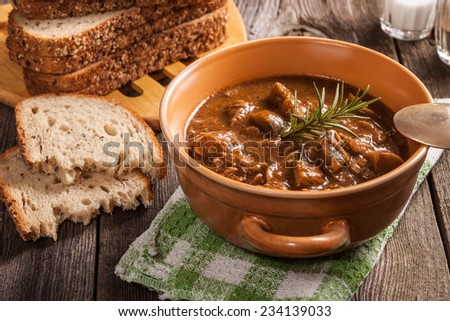 Goulash soup with pork and mushrooms. - stock photo