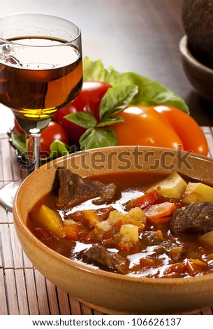 Goulash with  beef, potatoes and red pepper - stock photo