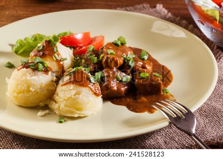 Goulash with boiled potatoes and vegetables - stock photo