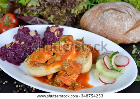 Goulash with red cabbage and bread dumplings - stock photo