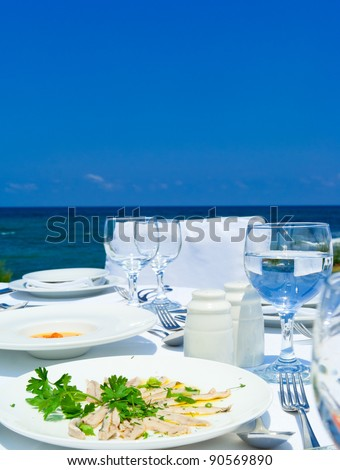 Gourme lunch  with seafood on mediterranean shore.Crete.Greece. - stock photo