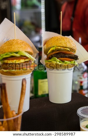 Gourmet Burger Sliders Served on Top of White Cups with French Fries - stock photo