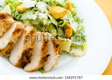 Gourmet caesar salad with grilled chicken croutons. - stock photo