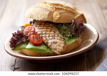 gourmet chicken sandwich with fresh and healthy ingredients - stock photo