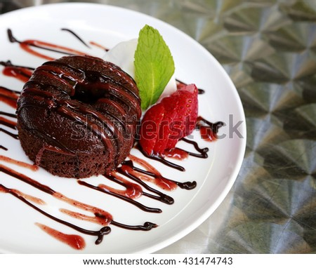 Gourmet chocolate desert on fancy decorated plate - stock photo