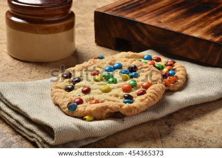 Gourmet cookies with chocolate candy topping on a napkin - stock photo