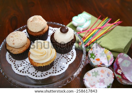 Gourmet cupcakes baked and frosted with icing vanilla - stock photo