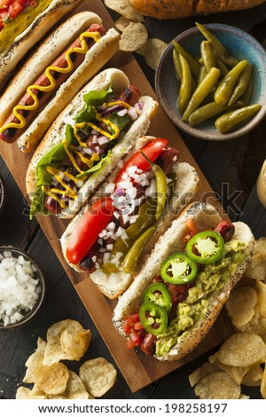 Gourmet Grilled All Beef Hots Dogs with Sides and Chips - stock photo
