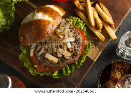 Gourmet Hamburger with Lettuce Tomato and Onions - stock photo