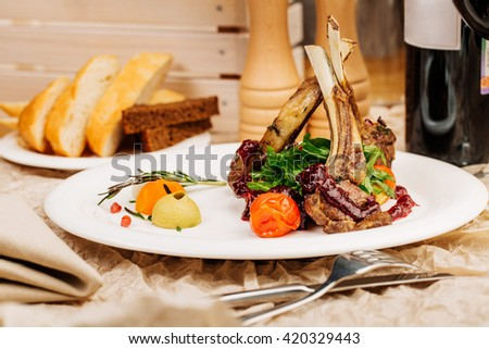 Gourmet Main Entree Course Grilled Lamb steak - stock photo