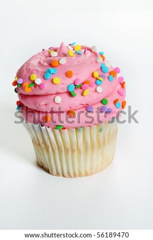 gourmet pink cupcake up close vertical - stock photo