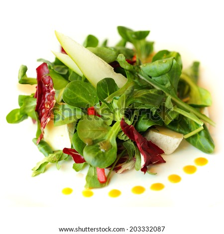 Gourmet salad with camembert cheese and pear - stock photo