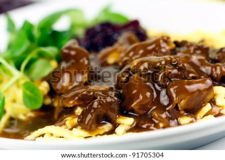 Gourmet Venison goulash with potato dumplings and garnish corn salad - stock photo