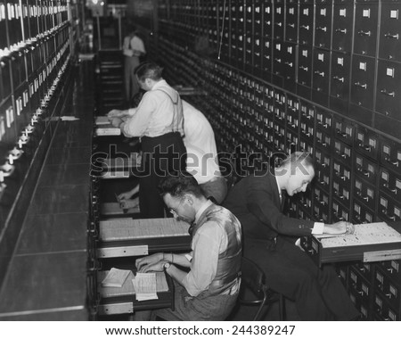 Government employees at the new Social Security Administration filing citizens applications for social security account numbers. Ca. 1937. - stock photo