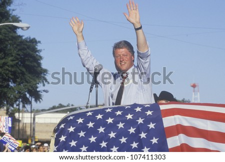 Governor Bill Clinton and right hand man Senator Al Gore wave to supporters at the County Court House during the Clinton/Gore 1992 Buscapade campaign tour in Athens, Texas - stock photo