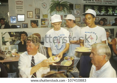 Governor Bill Clinton dines with the owner of Parma Peiroges Restaurant during the Clinton/Gore 1992 Buscapade campaign tour in Parma, Ohio - stock photo