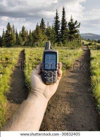 GPS at trail fork - stock photo