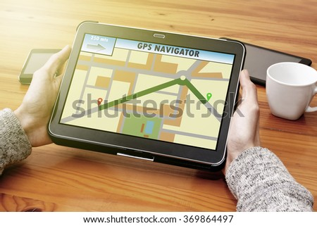 gps hands with the tablet on the desktop - stock photo