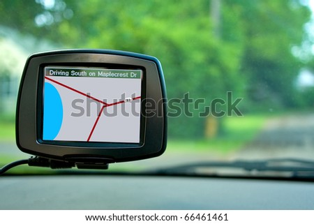 GPS Navigation system in a travelling car. - stock photo
